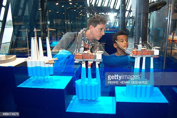 A woman shows an oil platform miniature replica to a child in Stavangers oil museum on November 12 2015 Sparkling wine instead of champagne companies...