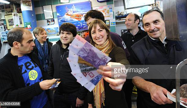 A woman shows banknotes of the 'Eusko' Basque currency on January 15 2013 after a press conference launching its circulation in the French Basque...
