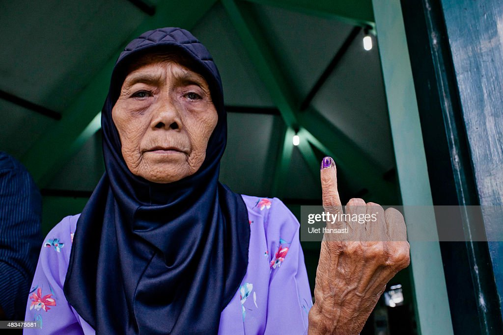 A woman shows her ink-stained finger after casting her ballot at polling station during the legislative elections on April 9, 2014 in Yogyakarta, Indonesia. Indonesia held legislative elections today, with the presidential election set to follow in three months on July 9.