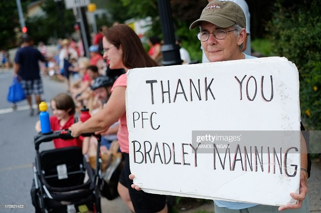 A woman shows her support for Bradley Manning during the Independence Day parade in Takoma Park, Maryland on July 4, 2013. Independence Day celebrates the declaration of independence from Britain in 1776. Manning who sent war logs and State Department cables to WikiLeaks, is charged with 21 offences, including aiding the enemy. AFP PHOTO/Mandel NGAN