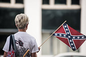 A woman shows her support for the Confederate battle flag at the South Carolina state house July 8 2015 in Columbia South Carolina South Carolina...