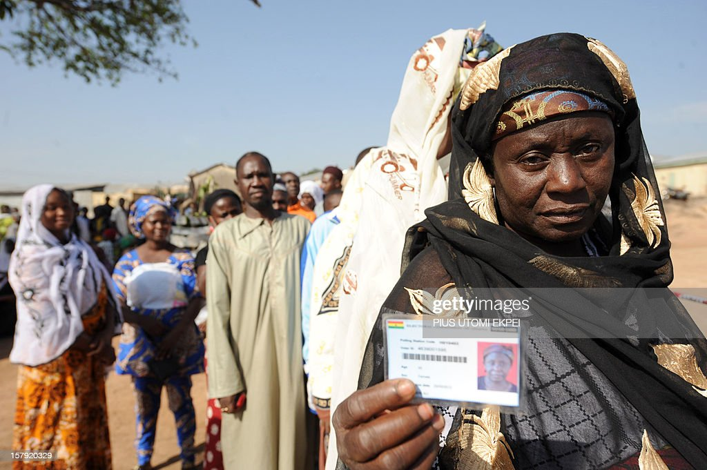 A woman shows her voter card prior to vote at Bole polling station in the northern region on December 7, 2012. Ghana voted in a high-stakes presidential election which is expected to be close, with the emerging country seeking to live up to its promise as a beacon of democracy in turbulent West Africa. AFP PHOTO/PIUS UTOMI EKPEI