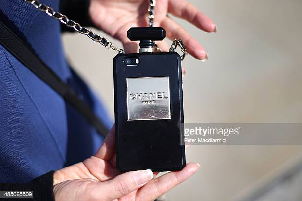 A woman shows off her Chanel branded mobile phone case on April 16 2014 in London England The capital continues to see growth and house price...