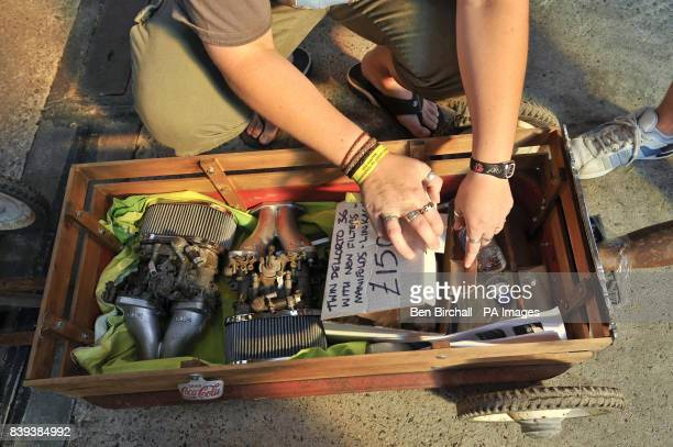 A woman shows off her Dellorto twin carburettors that sit in her customised Radio Flyer American style childrens trolley at Vanfest festival in the...