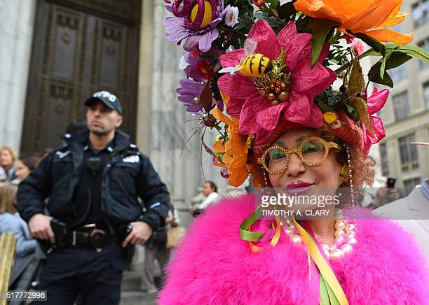 A woman shows off her Easter finery as she walks down Fifth Avenue in New York during the annual Easter Parade and Easter Bonnet Festival March 27...