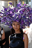 A woman shows off her hat during Ladies Day of Royal Ascot on June 19 2008 in London England