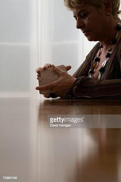 A woman shuffling tarot cards