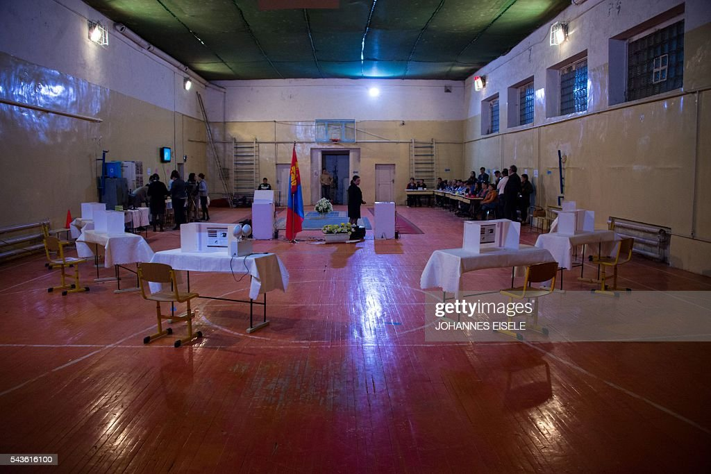 A woman shuts down the voting machine after the parliamentary elections in a polling station in Ulan Bator on June 29, 2016. Mongolians went to the polls across their sprawling, sparsely-populated country on June 29 as it struggles to benefit from its vast natural resources amid disputes over foreign investment and slumping demand from neighbouring China. It took Mongolian nomad Pagvajaviin Shatarbaatar seven days to get to his polling station to vote in in the general election -- accompanied by more than 2,000 sheep, goats and horses. EISELE