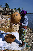 Woman sifting grain on beach, Joal-Fadiouth.