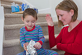 Woman signing the word 'Christmas' in American Sign Language while communicating with her son