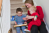 Woman signing the word 'Gift' in American Sign Language while communicating with her son