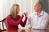 Woman signing word phrase 'Argument' in American Sign Language while communicating with a man