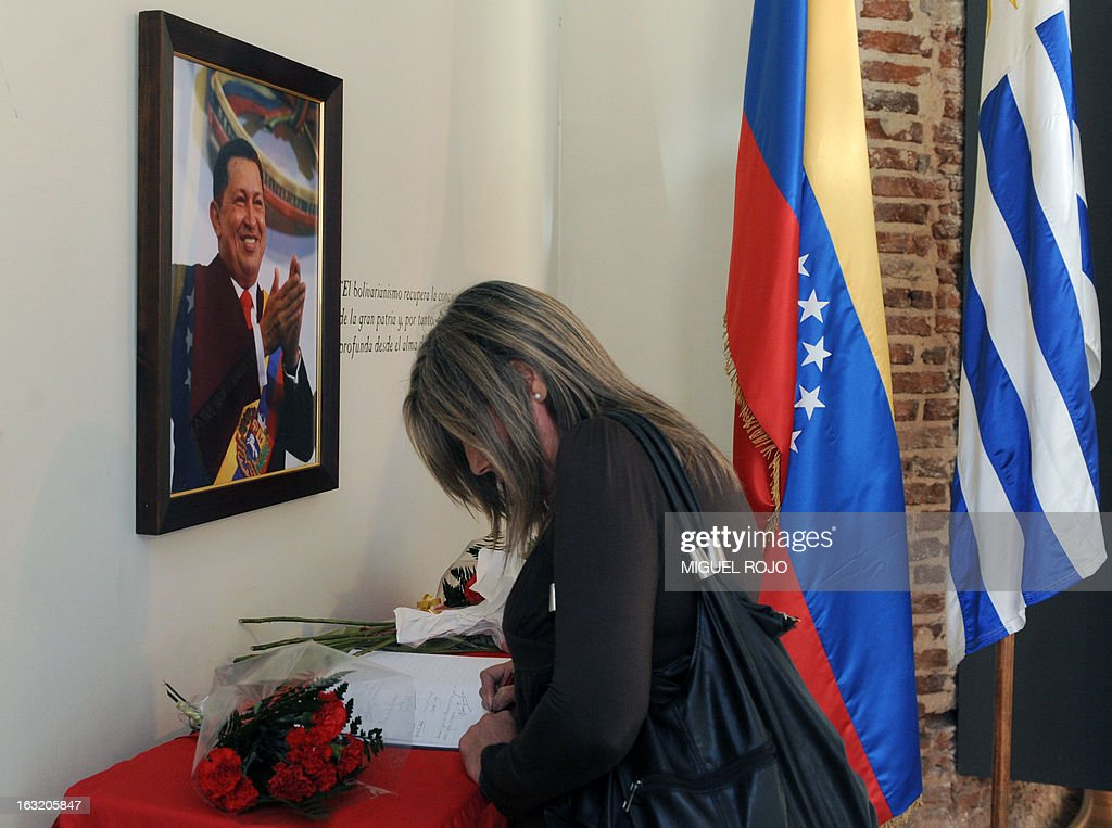 A woman signs a book of condolence at the Venezuelan embassy in Montevideo, on March 6, 2013, for the death of Venezuelan President Hugo Chavez on the eve. Condolences poured in Wednesday from world leaders who had found common cause with Venezuela's Hugo Chavez in his 14-year campaign to galvanize the Latin American left and defy US 'imperialism.' AFP PHOTO/Miguel ROJO