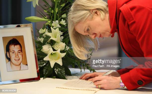 A woman signs a book of condolence for Pc Ronan Kerr a Catholic policeman who died in Omagh on Saturday when a booby trap bomb detonated under his...