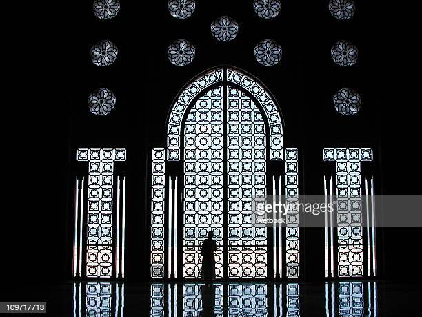 Woman silhouette in mosque
