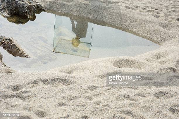 Woman silhouette in the puddle