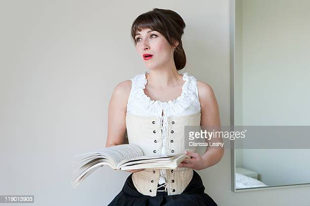 Woman singing from music book