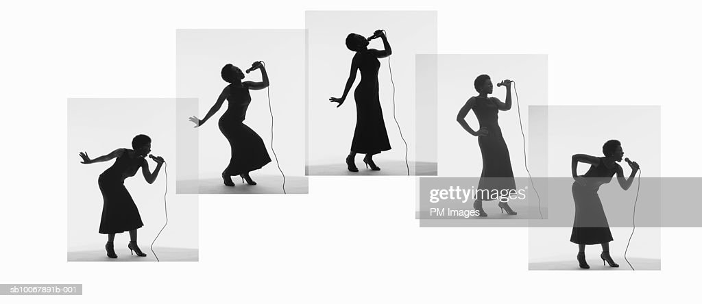 Woman singing on microphone : Stock Photo