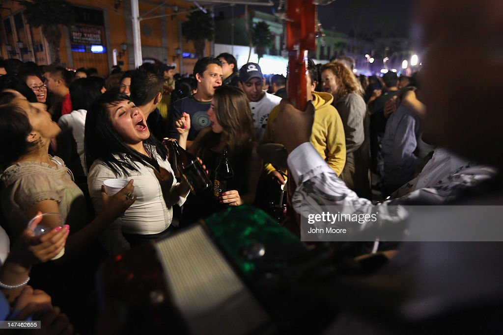 A woman sings along with mariachi music at Garibaldi Plaza early on June 30, 2012 in Mexico City, Mexico. Revelers partied into the early hours of the morning, even as a midnight ban on the sale of alcohol went into effect. The alcohol ban, known as 'ley seca' is meant to curb possible violence as Mexicans go to the polls Sunday to choose a new president.