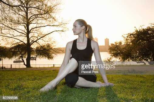 Woman siting in a yoga position : Stock-Foto