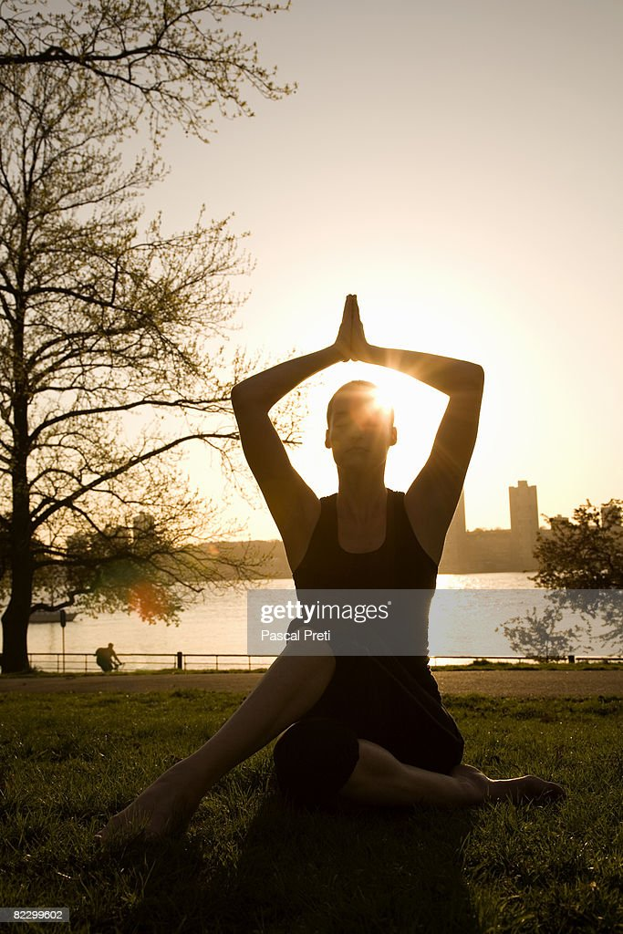 woman siting in a Yoga position,eyes closed : Stock Photo