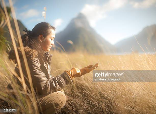 Woman siting in grass field