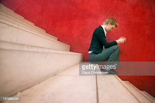 woman siting on stairway : Stock Photo