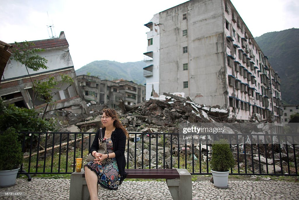 A woman sits at a earthquake memorial park at the Beichuan town in Sichuan province on April 24, 2013 in Chengdu, China. The Beichuan earthquake memorial was built in memory of the over 70,000 that perished in the deadly 2008 quake that struck Sichuan province and was built near the Beichuan Middle School, where over 1,000 students and teachers died. With the five year quake anniversary only a few weeks away, residents of Sichuan province are coming to grips with the April 20 earthquake in nearby Ya'An that claimed the lives of over 190 people and injured thousands.