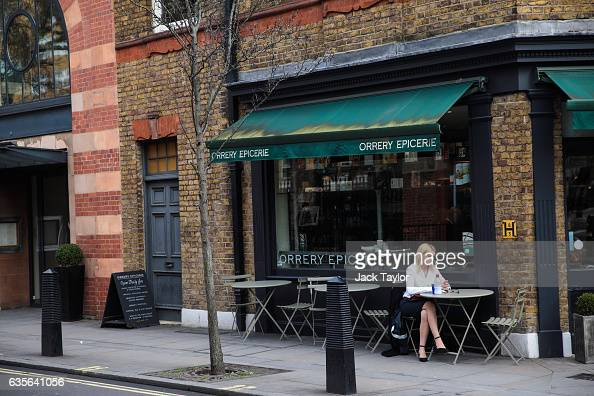 A woman sits at a Orrery Epicerie restaurant in Marylebone on February 16 2017 in London England The Association for Licensed Multiple Retailers have...