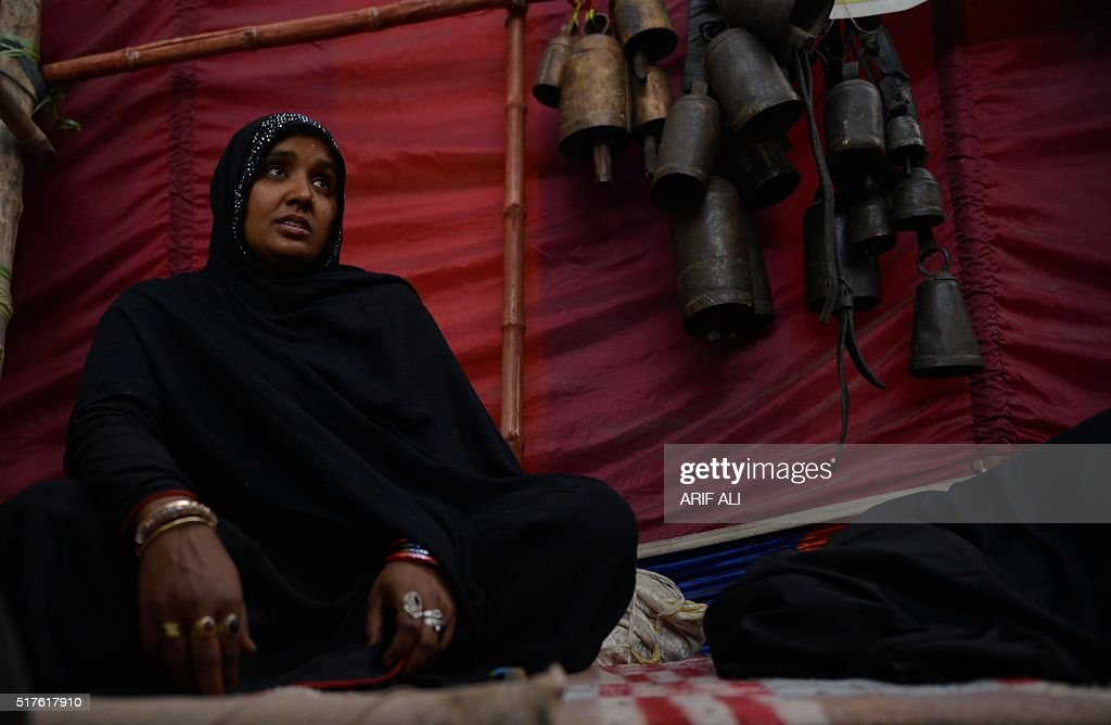 A woman sits at the shrine of Sufi saint Hazrat Shah Hussain popularly known as Madhu Lal Hussain during annual festival Mela Chiraghan in Lahore on...