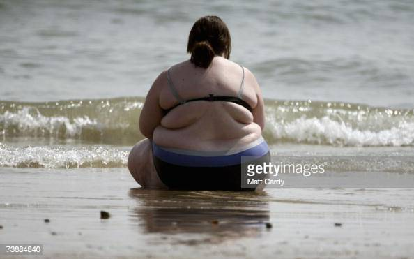 A woman sits at the water's edge as she enjoys the hot weather on the sea front on April 14 in Bournemouth England The unseasonably warm weather has...