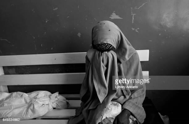 A woman sits by the body of a child in Mogadishu Somalia on Aug 27 2011