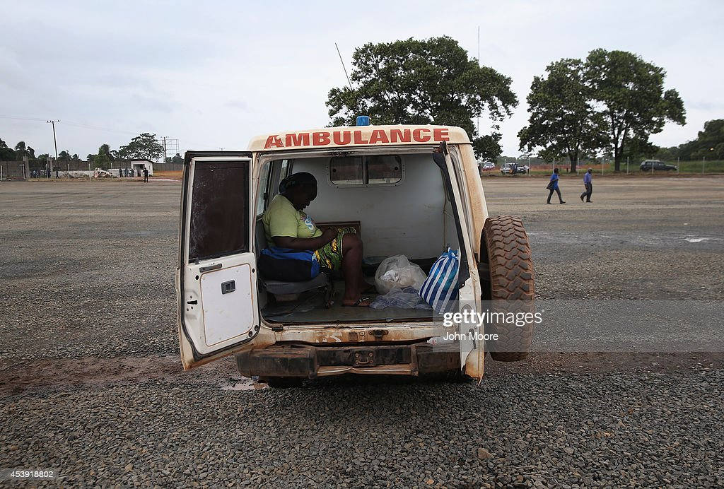 A woman sits dead in an ambulance after dying on the way to the Doctors Without Borders (MSF), Ebola treatment center on August 21, 2014 near Monrovia, Liberia. The Ebola epidemic has killed more than 1,200 people in West Africa.