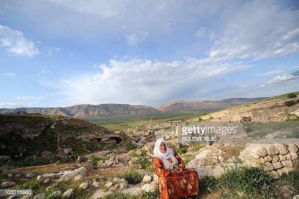 A woman sits high on the ramparts of Hasankeyf a small poverty stricken town on the banks of the Tigris on April 10 2010 Hasankeyf was once...