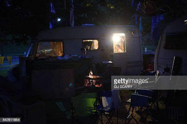 A woman sits in a caravan which is part of a protest camp of people calling for a second referendum on Scottish Independence located near to the...