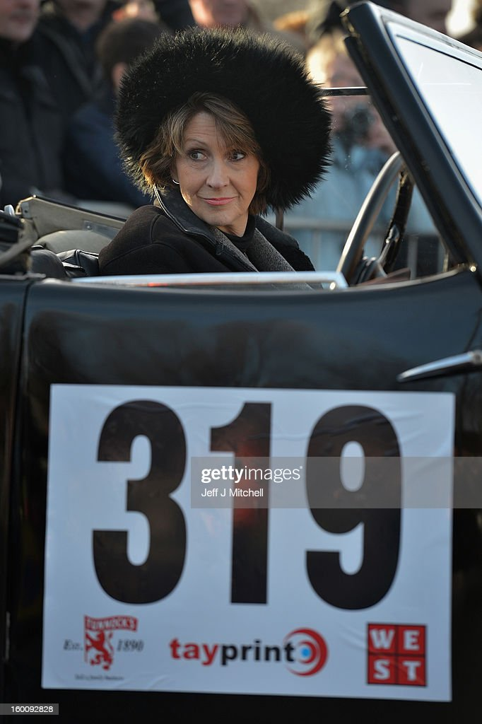 A woman sits in a classic car before the start of the Monte Carlo Classic Rally on January 26, 2013 in Glasgow. Around 100 cars set off from The People's Palace at Glasgow Green, they will pass through Kilmarnock and Dumfries on route to Monte Carlo via Dover.