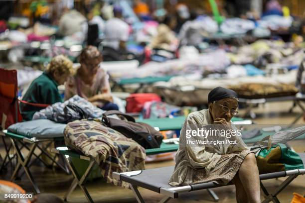 A woman sits in a couch at Roberto Clemente Coliseum the biggest shelter in the island Hurricane Irma is been expected over this night and tomorrows...