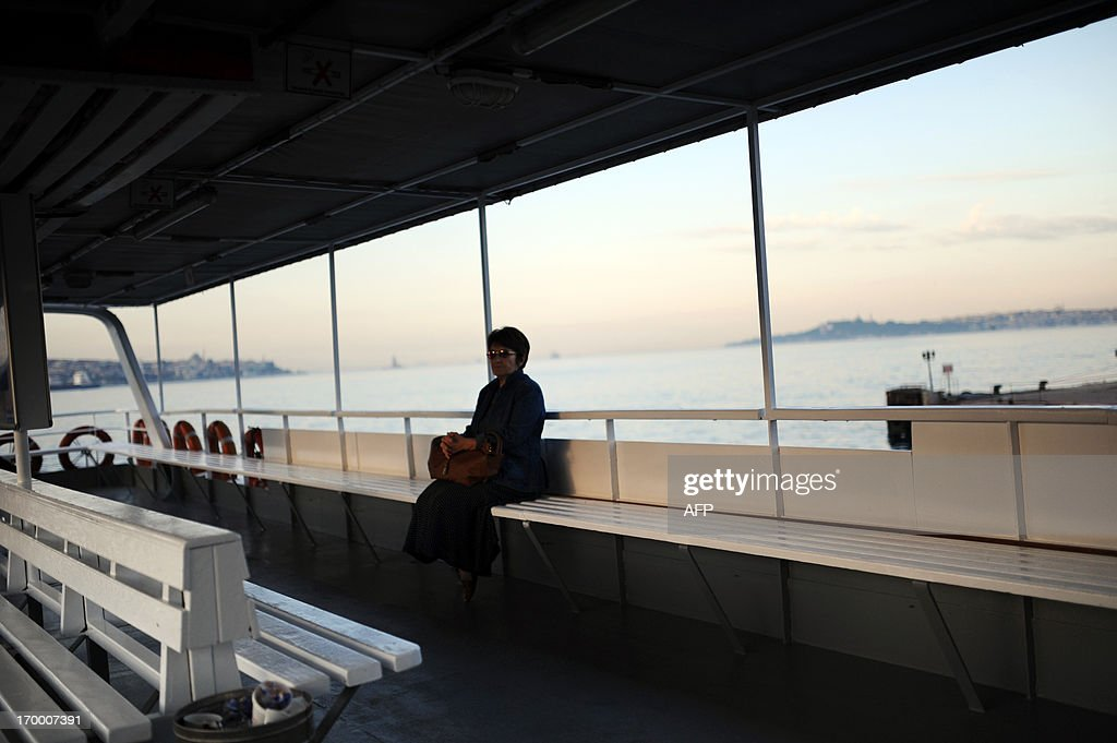 A woman sits in a ferry as she pass from European side to Asian side of Istanbul on June 6, 2013. Prime Minister Recep Tayyip Erdogan was due back in Turkey today after a trip abroad, with thousands of angry demonstrators calling for his resignation as protests entered a seventh day.