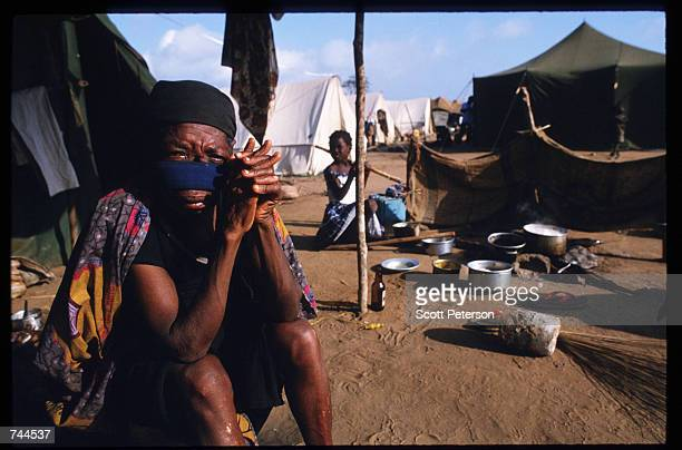 A woman sits in a refugee camp March 24 1993 in Huambo Angola Despite a 1991 peace treaty the West African nation is again embroiled in war as...