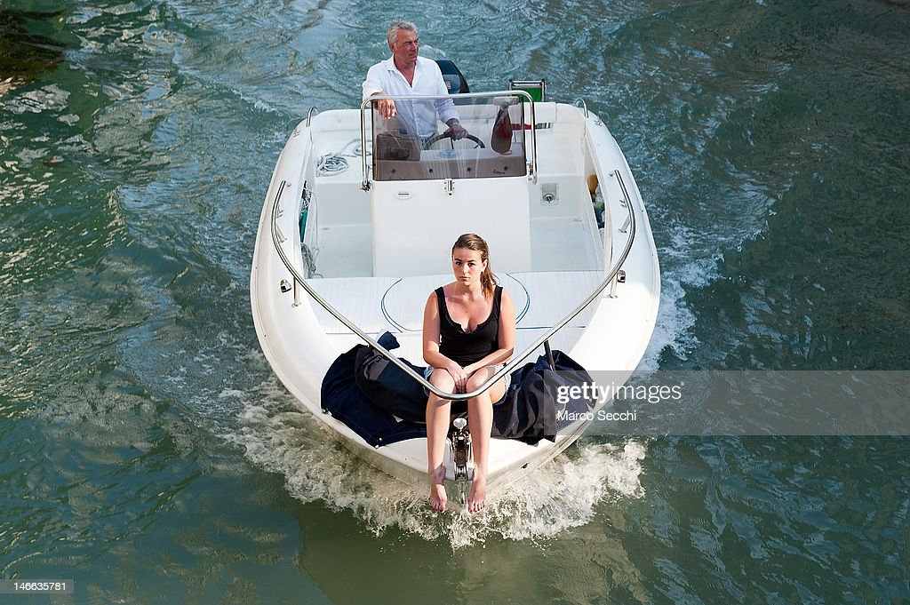 A woman sits in teh front of a power boat on June 21, 2012 in Venice, Italy. An intense heatwave is sweeping across many regions in Italy, prompting the country's health ministry to issue a number of high level alerts.