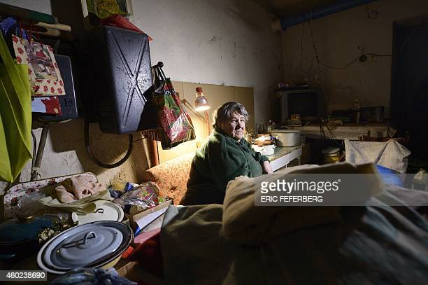 A woman sits in the cellar of her building used as a shelter in Kievskiy district witch is often sheld in the eastern Ukrain city of Donetsk...
