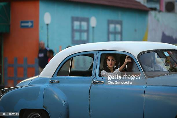 A woman sits in the front seat of a independent taxi in Centro Habana the neighborhood with the highest population density in the capital city...