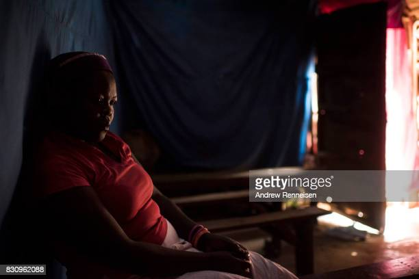 A woman sits inside Mwanzo Wa Dehema Church in the Kibera slum on August 13 2017 in Nairobi Kenya A day prior demonstrations turned violent in some...