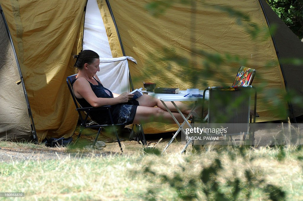 A woman sits near her tent, on August 21, 2012 in Albi, southwestern France, as the city swelters under a summer heatwave. The number of departments in heatwave orange alert was reduced by half, from 16 to 8, announced on August 21, 2012 by the French national meteorological service Meteo, indicating that the heatwave 'is coming to the end.' The eight departments which are still under orange alert are the Ain, Allier, Haute-Garonne, Isere, Loire, Puy-de-Dome, the Rhône and the Tarn.