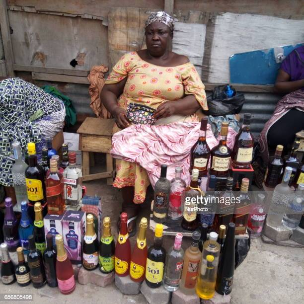 A woman sits near her wine along Broad Street in Lagos Nigeria on Wednesday March 22 2017 Nigeria currency naira hits six month high against dollar...