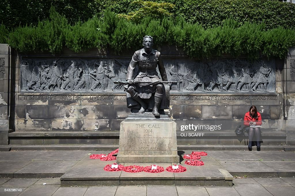 A woman sits next to a monument commemorating the First World War in Princes Street Gardens in the city centre of Edinburgh, Scotland on June 27, 2016. Britain's historic decision to leave the 28-nation bloc has sent shockwaves through the political and economic fabric of the nation. It has also fuelled fears of a break-up of the United Kingdom with Scotland eyeing a new independence poll, and created turmoil in the opposition Labour party where leader Jeremy Corbyn is battling an all-out revolt. SCARFF