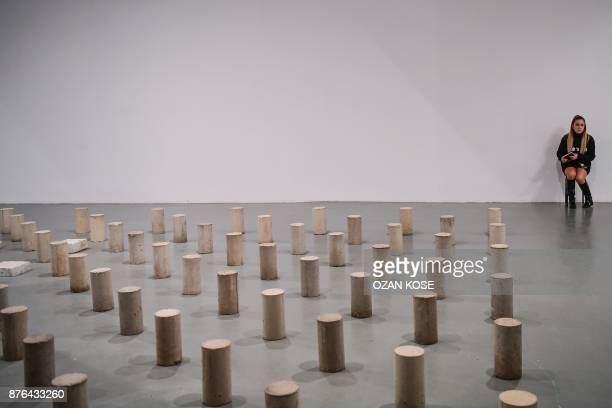 A woman sits next to an installation during the 15th Istanbul Biennial November 3 2017 Almost immediately after the failed coup against Erdogan last...