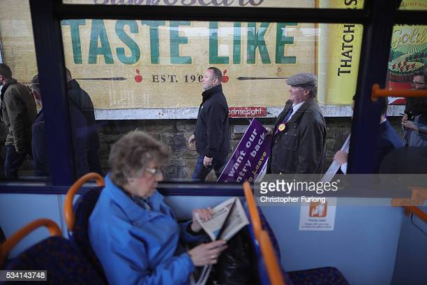 A woman sits on a bus as Vote Leave supporters follow UKIP leader Nigel Farage during campaigning for votes to leave the European Union on May 25...