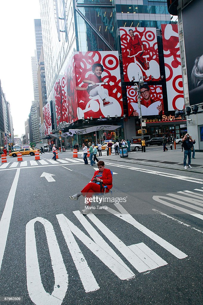 A woman sits on a lounge chair on Broadway in Times Square after it was converted to a pedestrian zone May 26, 2009 in New York City. Sections of Broadway that pass through Times Square and Herald Square have been closed to vehicles in an effort by the city to reduce traffic and pollution while giving pedestrians more space.