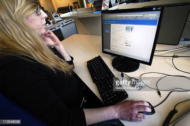 A woman sits on February 28 2011 in Tallinn in front of a computer to vote in the Estonian general election Data showed on March 3 that a record...